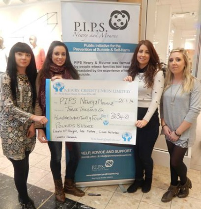 Girls who completed skydive donate to PIP's Newry and Mourne