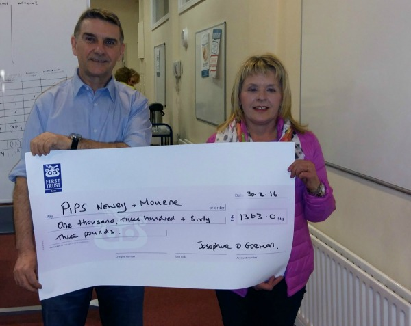 Josephine O Gorman presenting a cheque to Seamus McCabe from PIPS Newry & Mourne