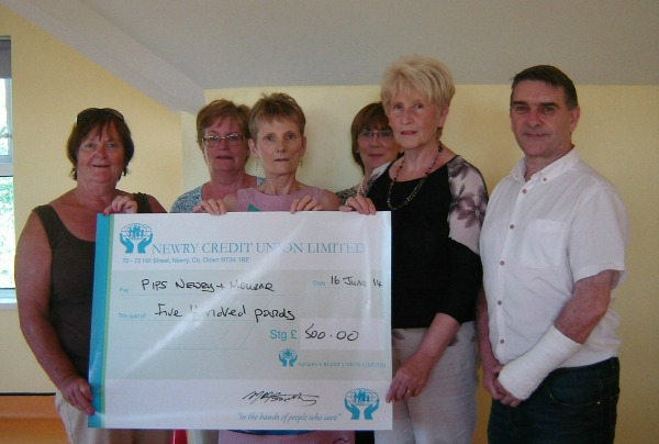Loughbrook Womans committee donate to PIPS Newry & Mourne