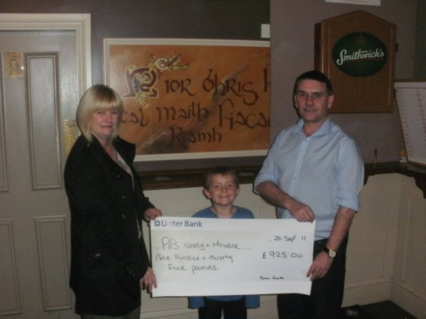 Susan Rocks and her son Keiran donate cheque to Seamus McCabe from PIPS Newry & Mourne
