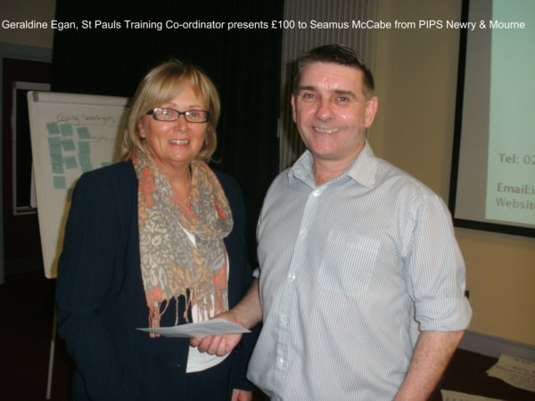 Geralding Egan Training Coordinator presents cheque for £100 to Seamus McCabe