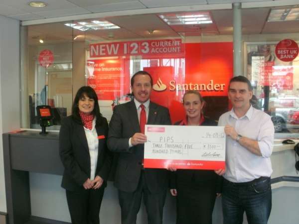Santander support The Meadow Lads donation to PIPS Newry & Mourne