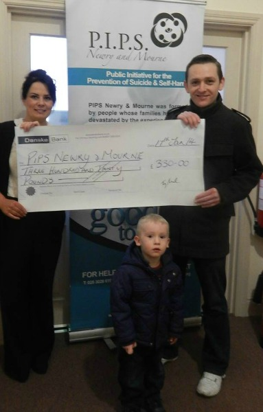 Terry McParland presents Olivia McShane PIPS Newry and Mourne with a cheque for £330.00