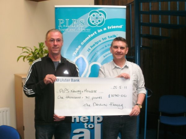 Gerald Devlin presenting a cheque for £1070.00 to Seamus, proceeds from the Josephine Devlin Memorial Match