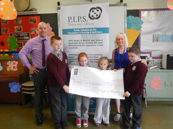 St. Josephs Primary school Ballymartin donate £140 to PIPS Newry and Mourne
