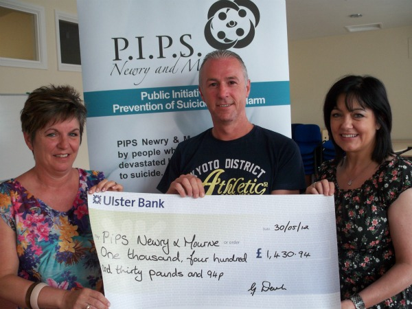Gerald Devlin presents cheque donation to Dympna Maguire