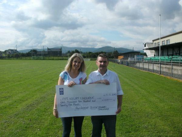 Tara Campbell from An Riocht GAA Club Kilkeel donates £1225.00 to PIPS Newry & Mourne